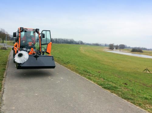 KM50-Sweeper-on-Holder-Tractor-2.jpg