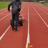 Cleaning-running-track-with-Kersten-sweeper-3